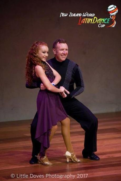 Proud Father dancing with daughter