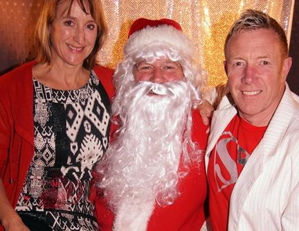 Donna & Warren of Latin Fire with Santa at Salsa Ball